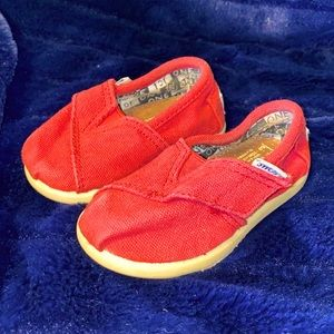 TOMS. RED SLIP ONS. VELCRO TOP TO ADJUST FITTING